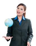 Businesswoman Throwing Globe Royalty Free Stock Photos