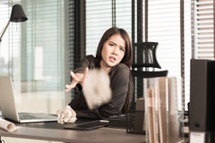 Businesswoman throwing out office documents Royalty Free Stock Photography