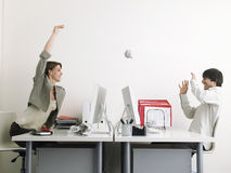 Businesswoman Throwing Paper Ball On Male Executive stock photos