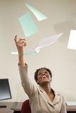 Businesswoman throwing paperwork in the air Royalty Free Stock Photo