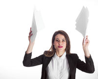 Businesswoman throwing paperwork. Young woman throwing away papers Royalty Free Stock Photos