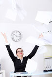 Businesswoman throwing sheets of paper. Royalty Free Stock Image