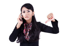 Businesswoman with thumb down Stock Photography