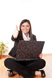 Businesswoman with a thumb up Stock Photo
