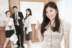 Businesswoman with thumb up Royalty Free Stock Image