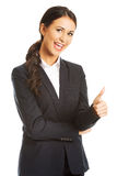 Businesswoman with thumb up gesture Stock Photo