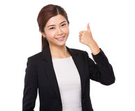 Businesswoman with thumb up Stock Images