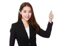 Businesswoman with thumb up Royalty Free Stock Photography