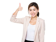 Businesswoman with thumb up Royalty Free Stock Photos