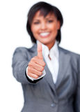 Businesswoman with thumb up smiling at the camera Stock Photography