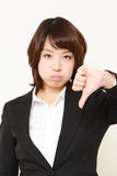 Businesswoman with thumbs down gesture Royalty Free Stock Image