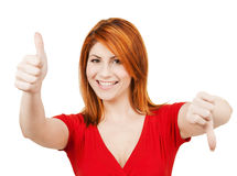 Businesswoman with thumbs up and down Stock Photos