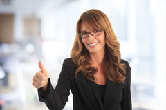 Businesswoman thumbs up Royalty Free Stock Image