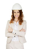 Businesswoman with thumbs up wearing helmet. Royalty Free Stock Photography