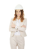 Businesswoman with thumbs up wearing helmet. Stock Images