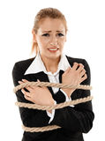 Businesswoman tied with a rope Stock Image