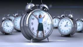 Businesswoman tied up on giant clock. On grey background stock footage