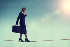 Businesswoman on a tightrope Royalty Free Stock Photography