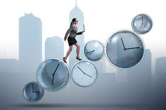 The businesswoman in time management concept Royalty Free Stock Photos
