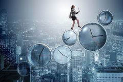 The businesswoman in time management concept Stock Image