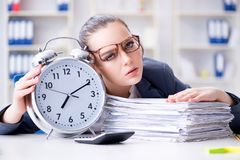 The businesswoman in time management concept Stock Photos