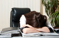 Businesswoman tired at work stock images