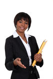 Businesswoman about to give a handshake. Royalty Free Stock Photography