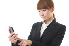 Businesswoman to see a smartphone. Young businesswoman to see a smartphone Royalty Free Stock Image