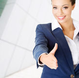 Businesswoman about to shake hands. Stock Photos
