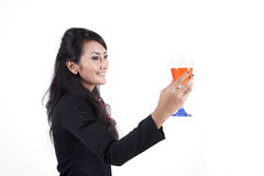 Businesswoman Toasting. Businesswoman holding a glass of red wine Royalty Free Stock Photos