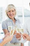 Businesswoman toasting with champagne in office Royalty Free Stock Photos