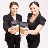 Businesswoman toasting with coffee cups. Two businesswomen toasting with coffee cups Stock Photo