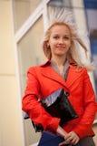 Businesswoman ton the walk. A blond beautiful woman outdoors Stock Image