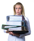 Businesswoman with too much paperwork Stock Photography