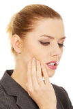 Businesswoman with tooth ache. Stock Photo