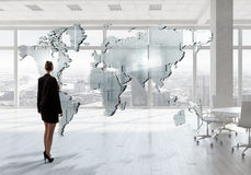 Businesswoman in top floor office Royalty Free Stock Images