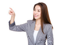 Businesswoman touch on imaginary panel Stock Photos