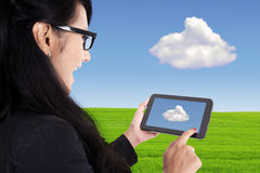 Businesswoman and touch pad, cloud computing concept Stock Photo