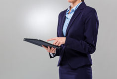 Businesswoman touch on the screen of digital tablet Royalty Free Stock Photos