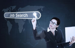 Businesswoman touches job search button Stock Image