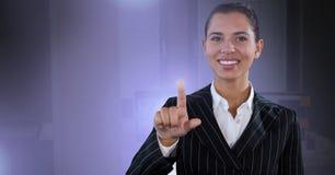Businesswoman touching air glow. Digital composite of Businesswoman touching air glow Stock Photo
