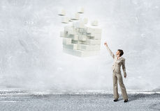 Businesswoman touching cube Royalty Free Stock Photo