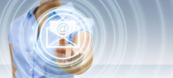 Businesswoman touching 3D rendering flying email icon with her f. Businesswoman on blurred background touching 3D rendering flying email icon with her finger Royalty Free Stock Photo