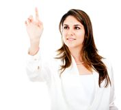 Businesswoman touching with finger Stock Photos