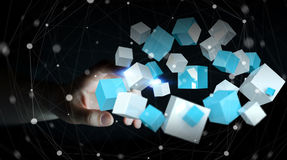 Businesswoman touching flying blue shiny cube 3D rendering Royalty Free Stock Photo