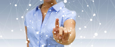 Businesswoman touching flying network sphere 3D rendering. Businesswoman on blurred background touching flying network sphere 3D rendering Royalty Free Stock Photography
