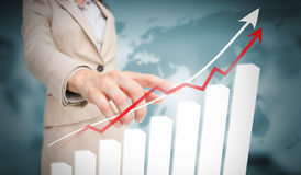 Businesswoman touching futuristic bar chart with arrow Royalty Free Stock Image
