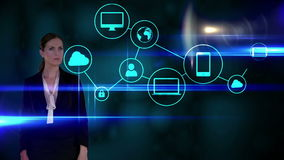 Businesswoman touching futuristic interface on black background stock video footage