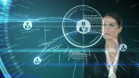 A businesswoman touching futuristic interface on black background stock footage