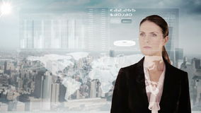 Businesswoman touching futuristic interface with city on background stock footage